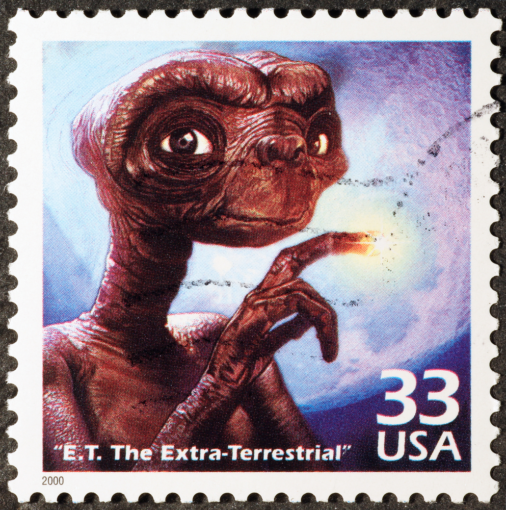 Slide 1 of 70: Milan, Italy - January 30, 2017: E.T. the Extraterrestrial on american postage stamp