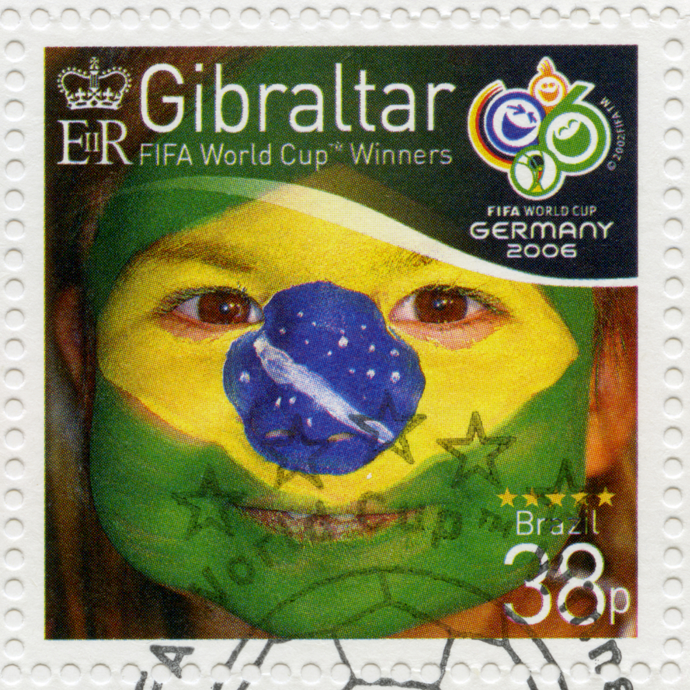 Slide 15 of 70: GIBRALTAR - CIRCA 2006 : A stamp printed in Gibraltar shows child with face painted as flag of Brazil, devoted 2006 World Cup Soccer Championships, Germany, circa 2006