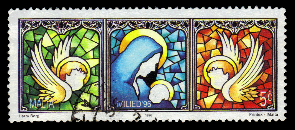 Slide 30 of 70: SINGAPORE – FEBRUARY 7, 2017: A stamp printed in Malta shows drawing of a window with the virgin and the child and the angels, circa 1996