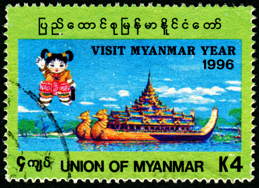 Slide 39 of 70: MYANMAR - CIRCA 1996: A stamp printed in Myanmar shows little girl and a temple, circa 1996