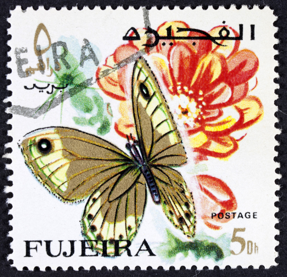 Slide 58 of 70: GROOTEBROEK ,THE NETHERLANDS - MARCH 20,2016 : Postage stamp from Fujairah or Fujeira ca. 1967 showing the colorful drawing of a butterfly and a flower