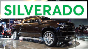 a car parked in front of a store: 2018 Detroit Auto Show: 2019 Chevrolet Silverado