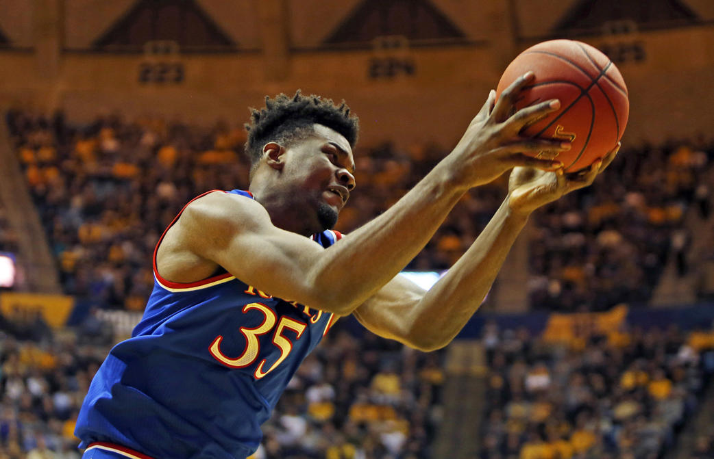Slide 1 of 15: MORGANTOWN, WV - JANUARY 15:  Udoka Azubuike #35 of the Kansas Jayhawks pulls down a rebound against the West Virginia Mountaineers at the WVU Coliseum on January 15, 2018 in Morgantown, West Virginia.