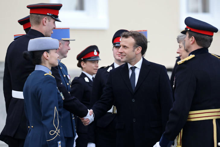 French President Emmanuel Macron (C) and Britain's Prime Minister Theresa May (2nd R) meet with French and British military cadets at the Royal Military Academy Sandhurst, west of London on January 18, 2018