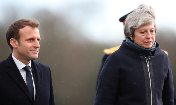France's President Emmanuel Macron and Britain's Prime Minister Theresa May inspect the troops at Sandhurst Military Academy in Sandhurst, Britain, January 18, 2018.