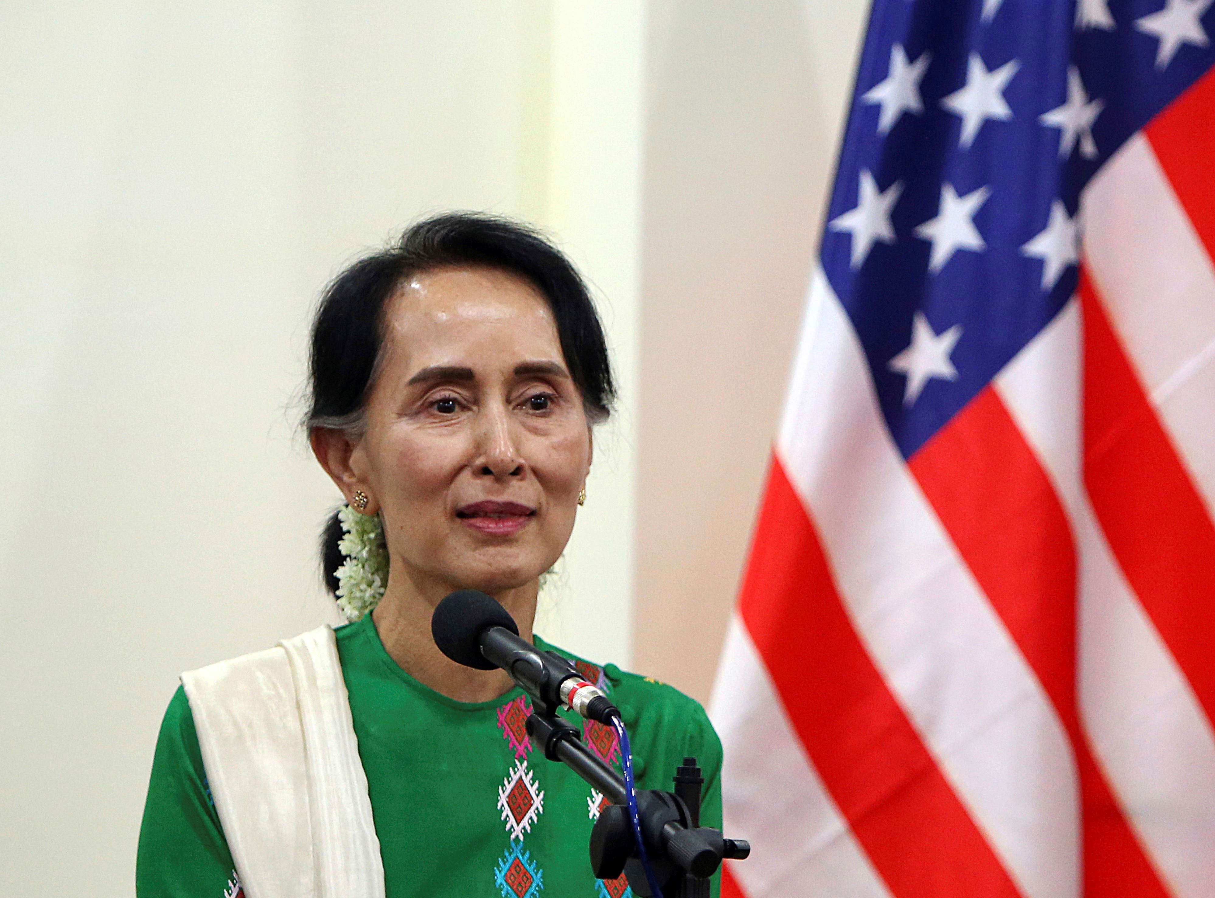 Slide 9 of 35: Myanmar leader Aung San Suu Kyi smiles during a press briefing with U.S. Secretary of State Rex Tillerson (not in photo) at the Foreign Ministry office in Naypyitaw, Myanmar, Wednesday, Nov. 15, 2017. (AP Photo/Aung Shine Oo)