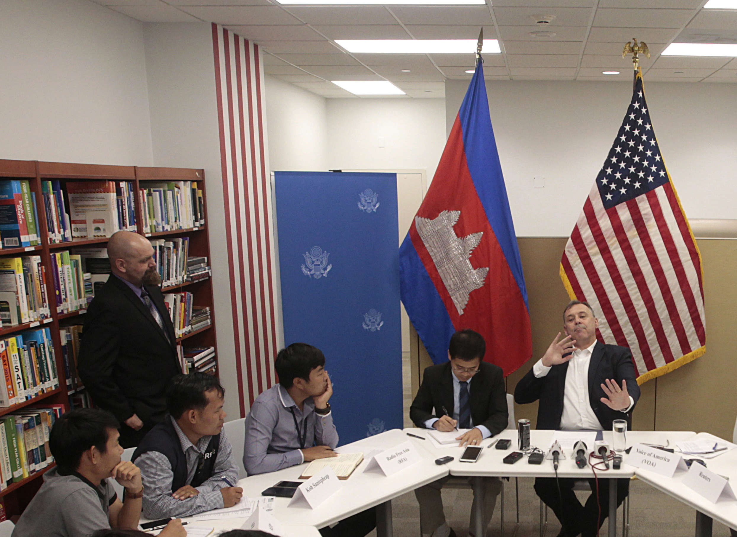 Slide 10 of 35: U.S. Ambassador to Cambodia William Heidt, rear center, gives a press conference at the U.S. Embassy in Phnom Penh, Cambodia, Tuesday, Sept. 12, 2017. Heidt has delivered sharp response to allegations by Prime Minister Hun Sen that Washington is seeking to dislodge his government, denying the allegations and warning that Cambodia is doing itself damage international with its anti-American campaign. (AP Photo/Heng Sinith)