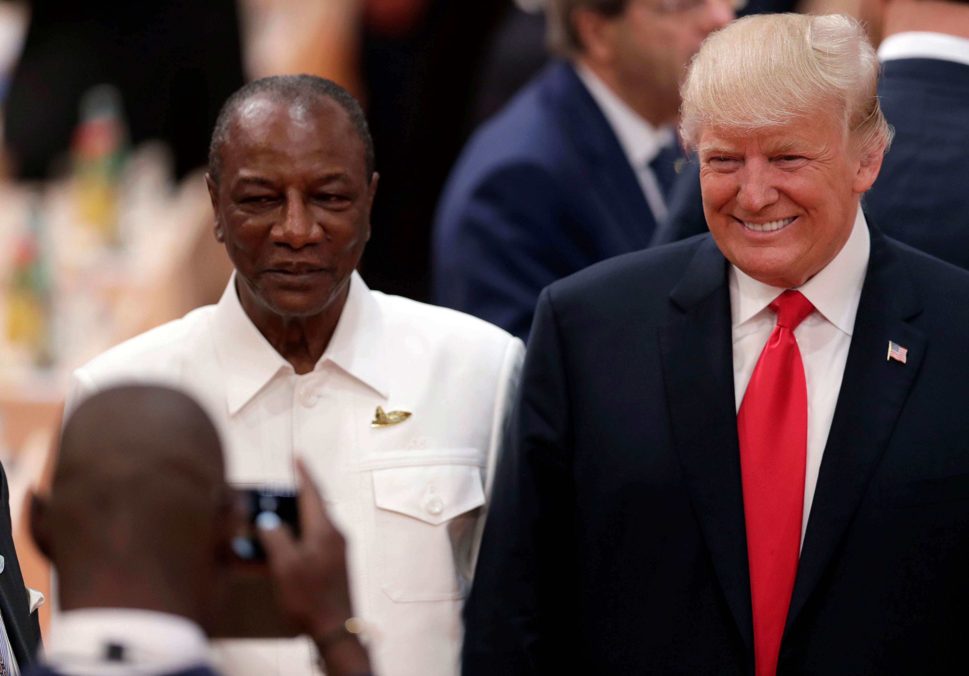 Slide 18 of 35: The Chairman of the African Union and President of Guinea Alpha Conde, left, and U.S. President Donald Trump, right, pose for a selfie prior to a working session at the G-20 summit in Hamburg, northern Germany, Saturday, July 8, 2017. The leaders of the group of 20 meet July 7 and 8. (AP Photo/Michael Sohn)