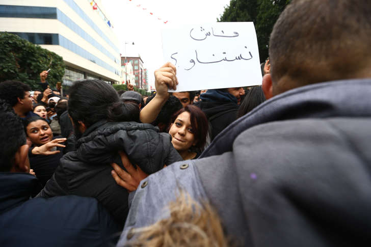 A protester holds a placard during a demonstration against price hikes on Avenue Habib Bourguiba in front of Municipal Theatre of Tunis, Tunisia on January 09, 2018.