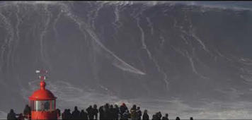 Surfer rides monster wave off the coast of Portugal