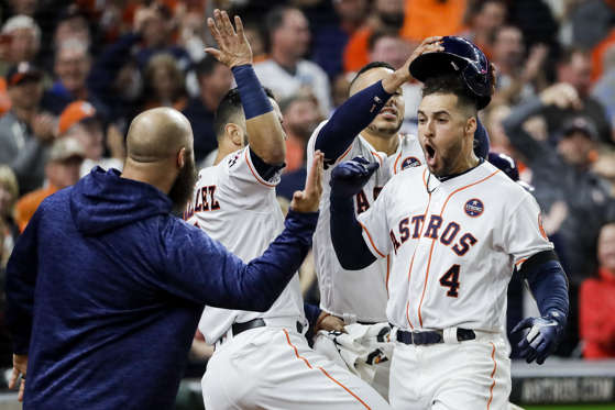Slide 12 of 39: Astros' George Springer celebrates after hitting a home run during the sixth inning of Game 4 of World Series against Dodgers on Oct. 28 in Houston. Dodgers won 6-2.