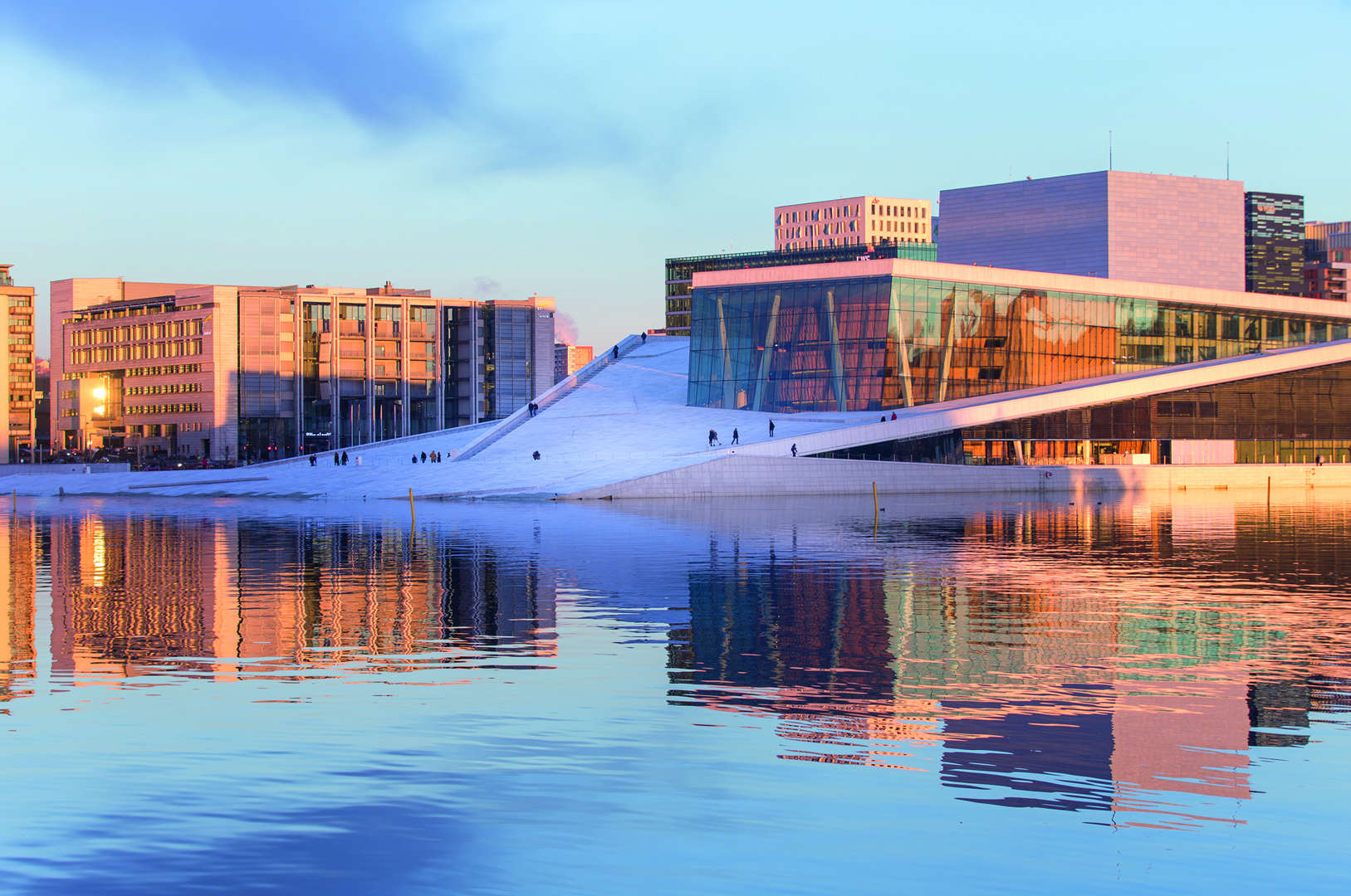 Slide 3 dari 21: The clean diagonals of Oslo Opera House have been a fixture