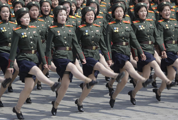 Women soldiers march across Kim Il Sung Square during a military parade
