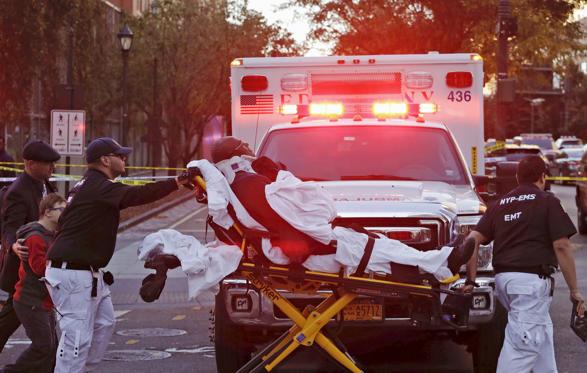 Manhattan,medics take victim to hospital