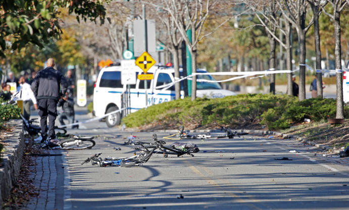 Slide 4 of 13: Multiple bikes are crushed along a bike path in lower Manhattan in New York on Oct. 31, 2017.
