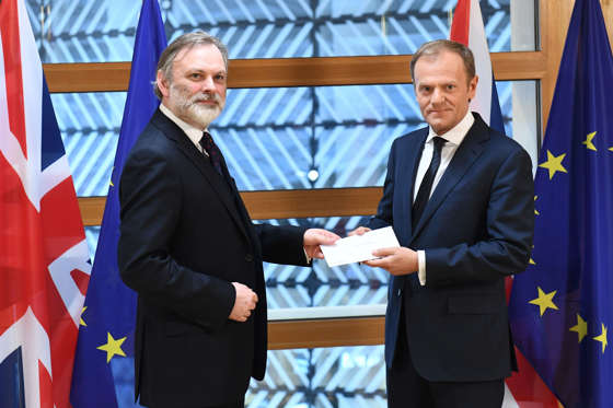 Slide 10 of 37: Britain's ambassador to the EU Tim Barrow delivers British Prime Minister Theresa May's formal notice of the UK's intention to leave the bloc under Article 50 of the EU's Lisbon Treaty to European Council President Donald Tusk in Brussels on March 29, 2017.