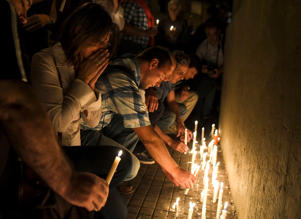 "People place candles during a vigil organised in front of the ""Politecnico"" high school, where the five Argentine citizens killed on Oct. 31 in the New York truck attack, were graduated 30 years ago in Rosario, some 350 Km north-west of Buenos Aires on Nov. 1.  Eight people were killed and eleven others were seriously hurt when the truck driver struck in broad daylight just blocks from the 9/11 Memorial, on the West Side of Lower Manhattan, close to schools as children and their parents geared up to celebrate Halloween. The Argentine victims were visiting New York for a school reunion."
