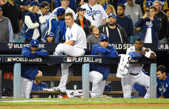 Slide 4 of 61: Los Angeles Dodgers players react from the dugout in the 9th inning against the Houston Astros in game seven of the 2017 World Series at Dodger Stadium.