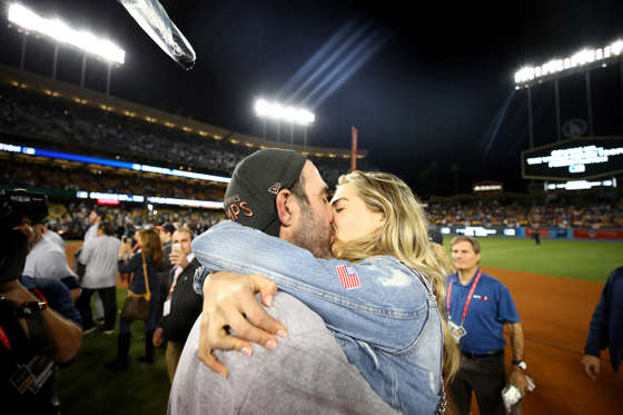 Slide 3 of 61: Justin Verlander #35 of the Houston Astros celebrates with fiancee Kate Upton after the Astros defeated the Los Angeles Dodgers 5-1 in game seven to win the 2017 World Series at Dodger Stadium on November 1, 2017 in Los Angeles, California.