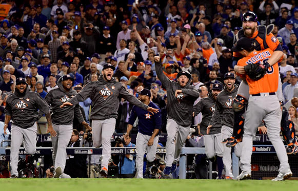 Slide 1 of 61: The Houston Astros celebrate defeating the Los Angeles Dodgers 5-1 in game seven to win the 2017 World Series at Dodger Stadium on November 1, 2017 in Los Angeles, California.