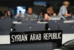 A sign marks the desk of the Syrian delegation at the COP23 United Nations climate change conference in Bonn, Germany, on Tuesday.