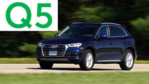a car parked in front of a sign: 2018 Audi Q5 Road Test