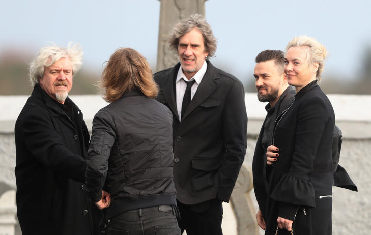 Band member Mike Hogan (second right) and his wife Siobhan arrive for the funeral of The Cranberries singer Dolores O'Riordan at Saint Ailbe's Church, Ballybricken