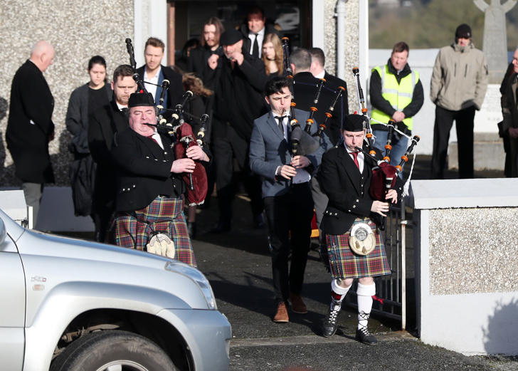 Pipers lead mourners following the funeral of The Cranberries singer Dolores O'Riordan at Saint Ailbe's Church, Ballybricken.