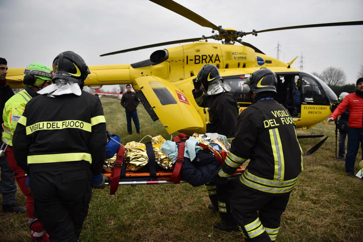 Italian rescuers evacuates a victim by helicopter on the site of a train derailment, on January 25, 2018 near Milan.