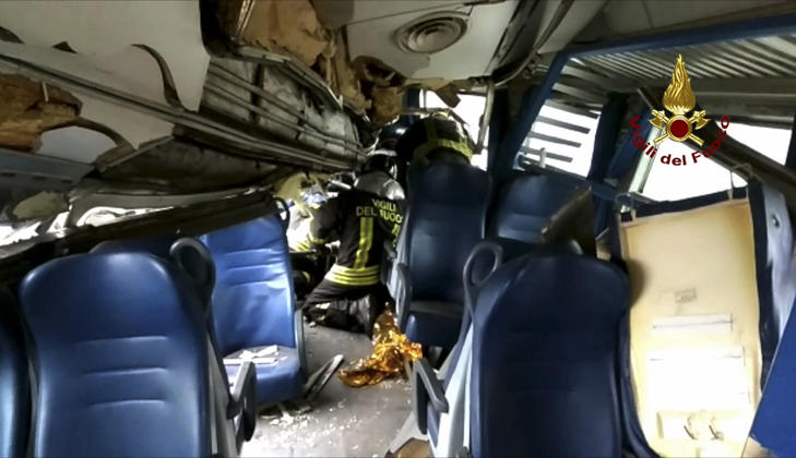This image provided by the Italian firefighters Vigili del Fuoco shows firefighters inside a train wagon
