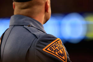 A New Jersey State Police trooper looks on in East Rutherford, New Jersey on February 2, 2014.