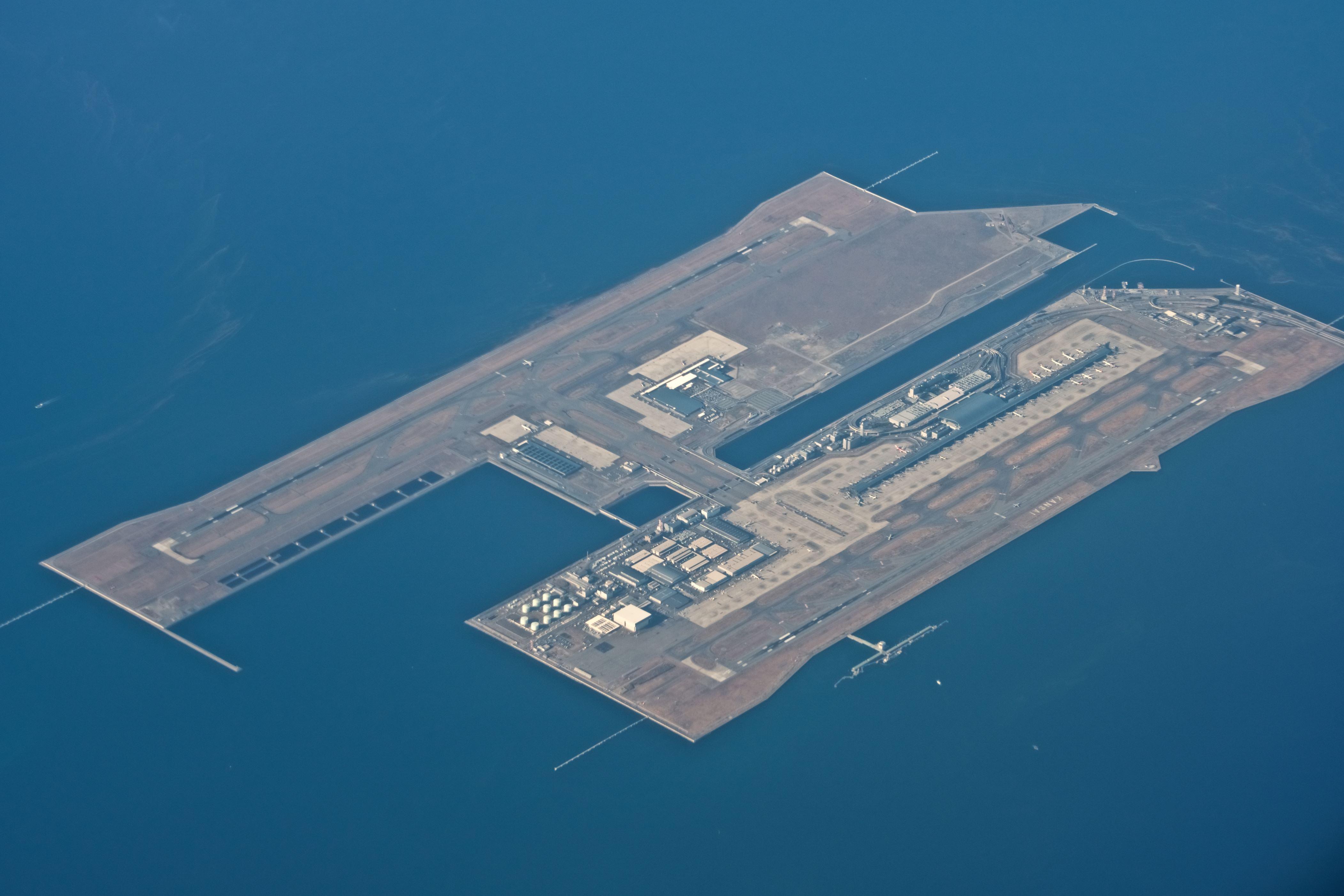 Slide 16 of 20: Kansai International Airport, daytime aerial view from airplane