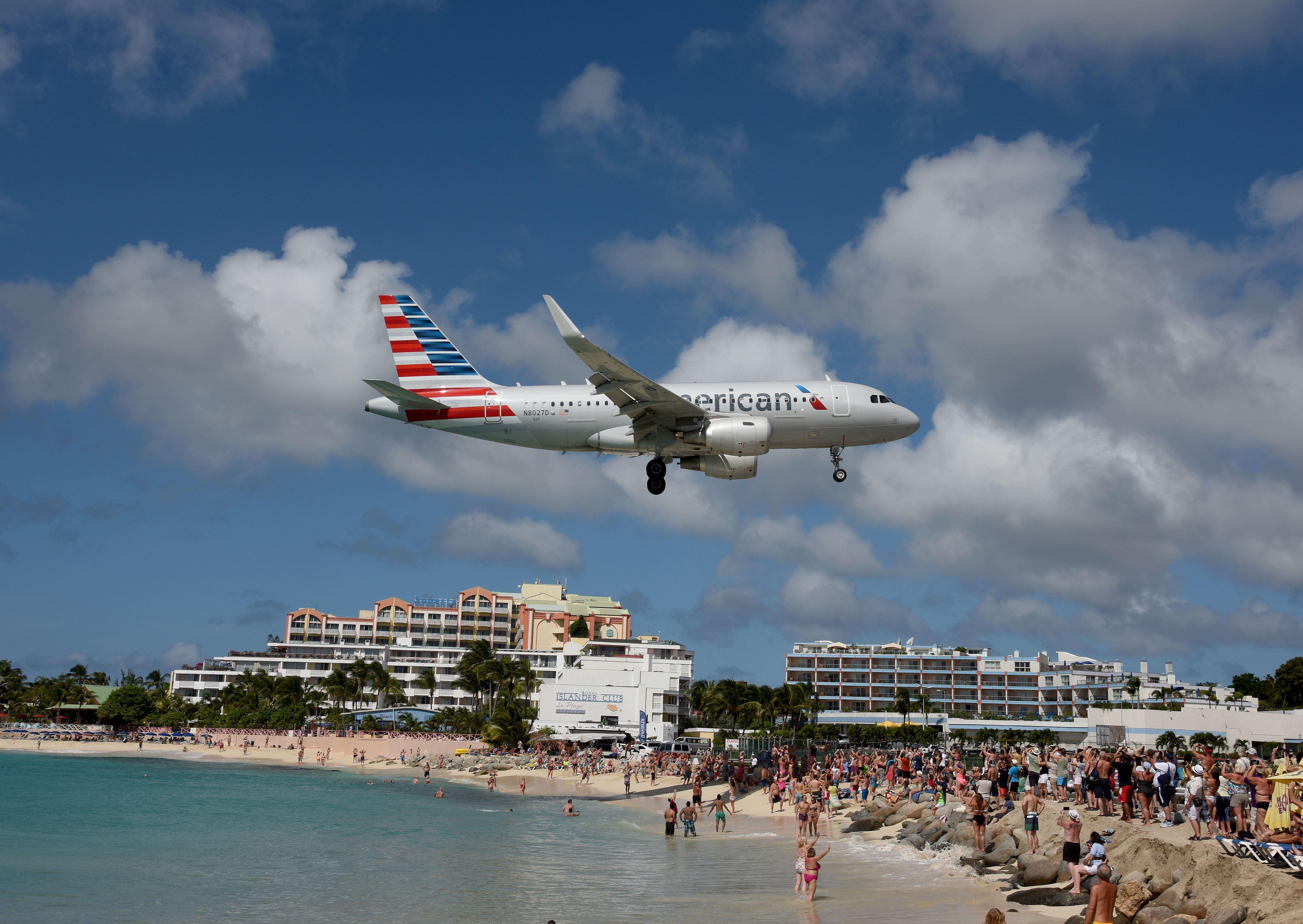 Slide 2 of 20: Maho Beach, Saint Maarten, West Indies - 16 Nov 2015 An American airlines flight from Miami arrives at Princess Juliana International airport in Saint Maarten