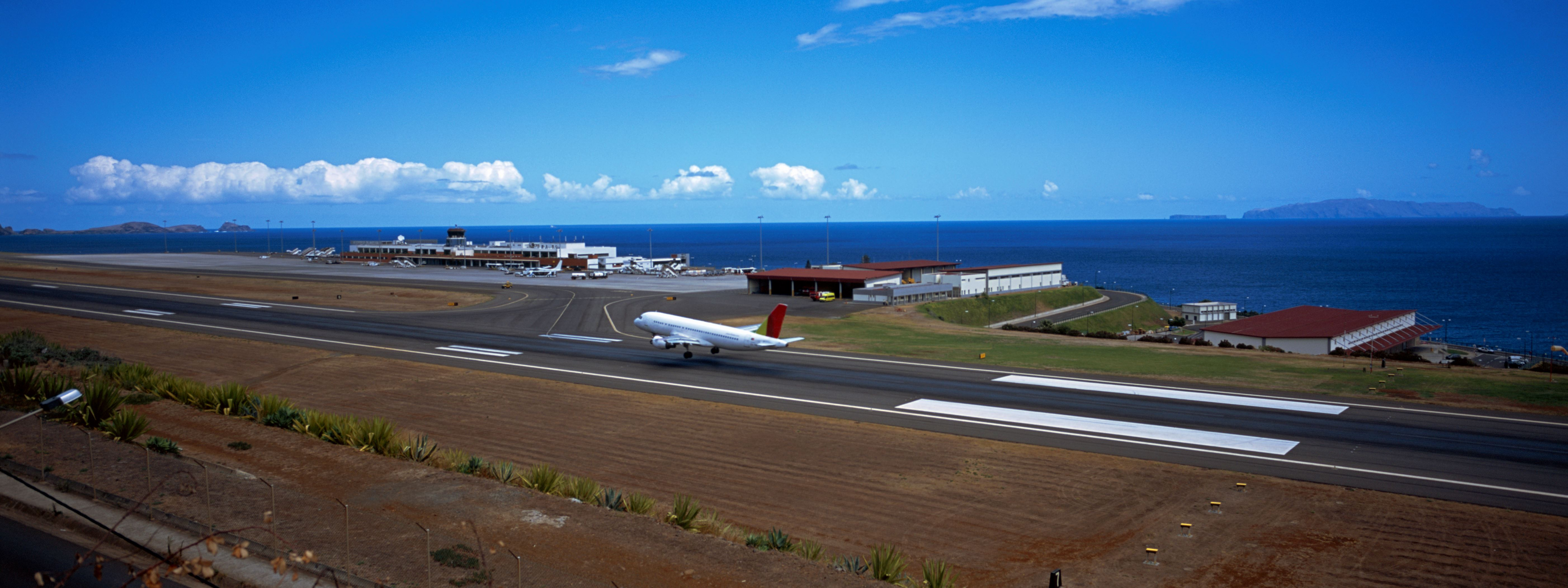 Slide 4 of 20: Airplane on the runway at an airport, Funchal Airport, Funchal, Madeira, Portugal
