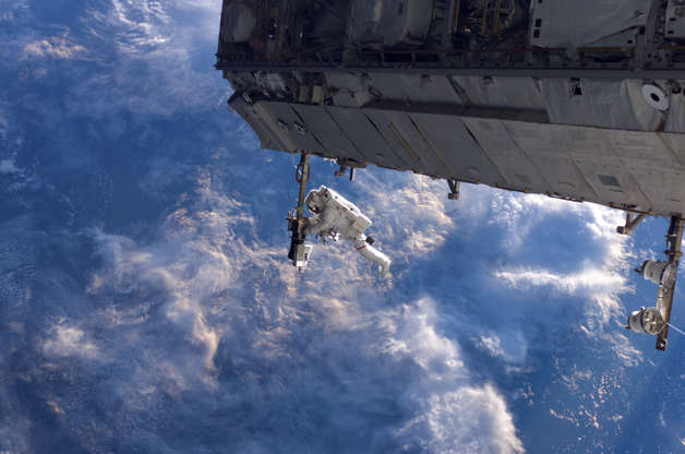 Slide 43 of 86: NASA astronaut Robert Curbeam works on the International Space Station's S1 truss during the space shuttle Discovery's STS-116 mission in Dec. 2006. European Space Agency astronaut Christer Fuglesang (out of frame) was his partner in the 6-hour, 36-minute spacewalk.