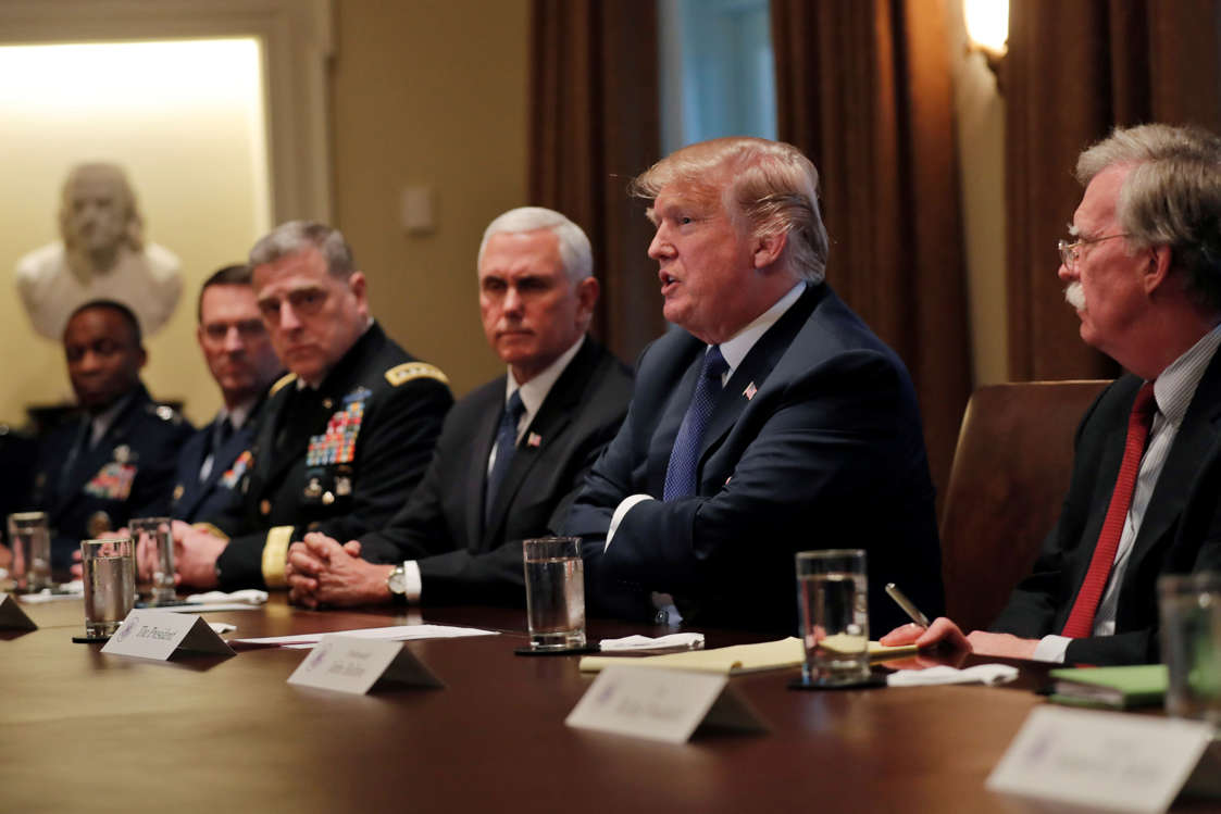 U.S. President Donald Trump receives a briefing from senior military leadership accompanied by Vice President Mike Pence and new National Security Adviser John Bolton (R) at the Cabinet Room of the White House in Washington, DC, U.S. April 9, 2018. REUTERS/Carlos Barria