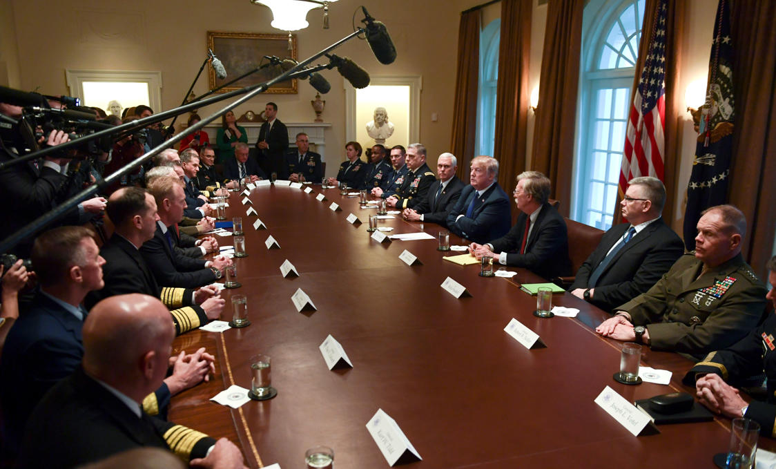 President Donald Trump, fourth from right, speaks in the Cabinet Room of the White House in Washington, Monday, April 9, 2018, at the start of a meeting with military leaders. Trump is flanked by Vice President Mike Pence, left, and national security adviser John Bolton, right. (AP Photo/Susan Walsh)
