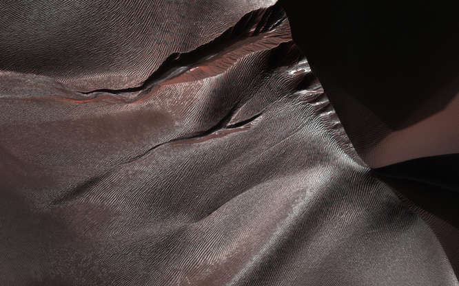 Slide 85 of 86: Gullies on Martian sand dunes, like these in Matara Crater, have been very active, with many flows in the last ten years. The flows typically occur when seasonal frost is present. In this image from NASA's Mars Reconnaissance Orbiter we see frost in and around two gullies, which have both been active before. (View this observation to see what these gullies looked like in 2010.) There are no fresh flows so far this year, but HiRISE will keep watching. The map is projected here at a scale of 50 centimeters (19.7 inches) per pixel. [The original image scale is 50.3 centimeters (19.8 inches) per pixel (with 2 x 2 binning); objects on the order of 151 centimeters (59.4 inches) across are resolved.] North is up. The University of Arizona, Tucson, operates HiRISE, which was built by Ball Aerospace & Technologies Corp., Boulder, Colorado. NASA's Jet Propulsion Laboratory, a division of Caltech in Pasadena, California, manages the Mars Reconnaissance Orbiter Project for NASA's Science Mission Directorate, Washington.