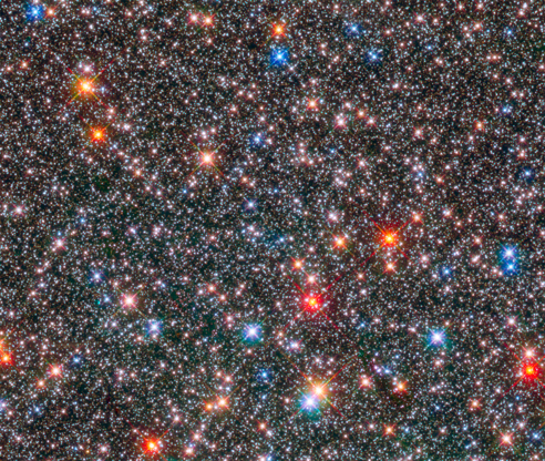 Slide 86 of 86: This Hubble Space Telescope image of a sparkling jewel box full of stars captures the heart of our Milky Way galaxy. The image is a composite of exposures taken in near-infrared and visible light with Hubble's Wide Field Camera 3. The observations are part of two Hubble surveys: the Galactic Bulge Treasury Program and the Sagittarius Window Eclipsing Extrasolar Planet Search.