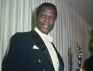 Bahamian American actor Sidney Poitier holding his Academy Award for Best Actor in a Leading Role for 'Lilies Of The Field'