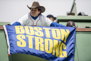 BOSTON, MA - APRIL 3: Boston Marathon bombing hero Carlos Arredondo holds a 'Boston Strong' flag before the Boston Red Sox home opener against the Pittsburgh Pirates on April 3, 2017 at Fenway Park in Boston, Massachusetts. (Photo by Billie Weiss/Boston Red Sox/Getty Images)