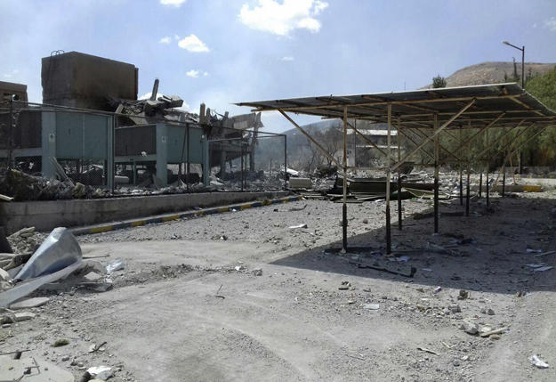 In this photo released by the Syrian official news agency SANA, shows the damage of the Syrian Scientific Research Center which was attacked by U.S., British and French military strikes to punish President Bashar Assad for suspected chemical attack against civilians, in Barzeh, near Damascus, Syria, Saturday, April 14, 2018.