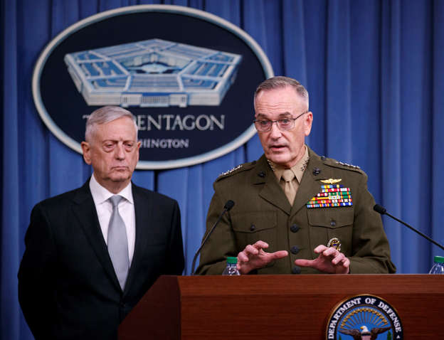Defense Secretary Jim Mattis, joined by Joint Chiefs Chairman Gen. Joseph Dunford, speaks at the Pentagon, Friday, April 13, 2018, on the U.S. military response, along with France and Britain, to Syria's chemical weapon attack on April 7.​ (AP Photo/Carolyn Kaster)