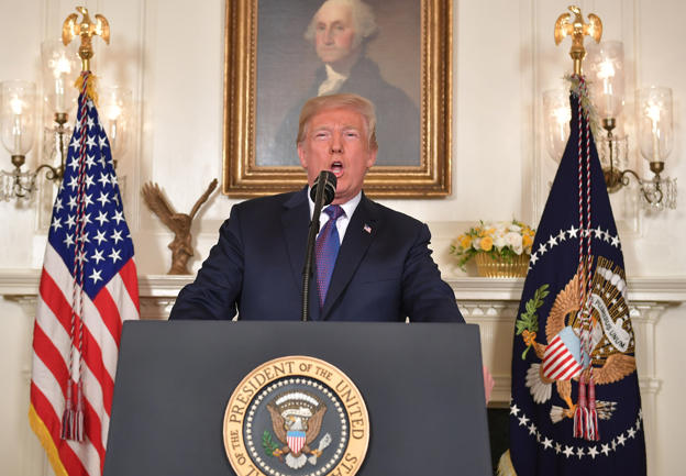 TOPSHOT - US President Donald Trump addresses the nation on the situation in Syria April 13, 2018 at the White House in Washington, DC. Trump said strikes on Syria are under way.  / AFP PHOTO / Mandel NGAN        (Photo credit should read MANDEL NGAN/AFP/Getty Images)