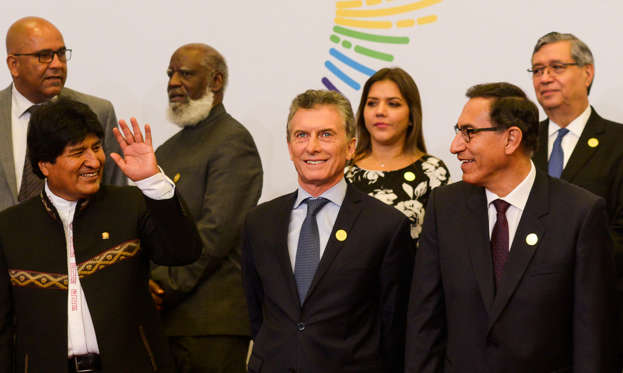 Bolivia's President Evo Morales, Argentina's President Mauricio Macri and Peru's President Martin Vizcarra pose for the family photo during the VIII Summit of the Americas in Lima, Peru April 14, 2018. Argentine Presidency/Handout via REUTERS ATTENTION EDITORS - THIS IMAGE WAS PROVIDED BY A THIRD PARTY.
