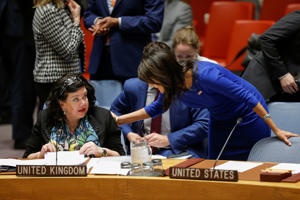 United States Ambassador to the United Nations Nikki Haley greets Karen Pierce, UK Ambassador to the United Nations at the beginning of the emergency United Nations Security Council meeting on Syria at the U.N. headquarters in New York, U.S., April 14, 2018.
