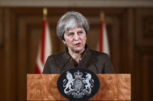 Britain's Prime Minister Theresa May attends a press conference in 10 Downing Street, London, April 14, 2018.