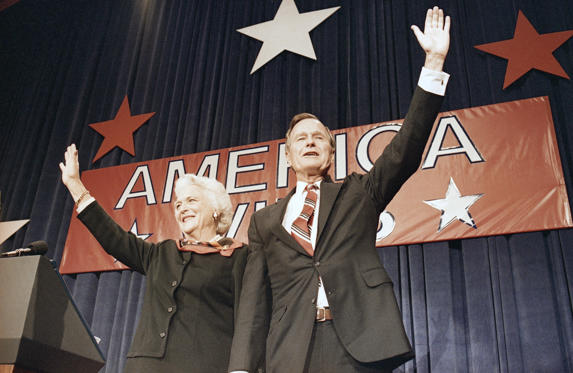 Slide 11 of 28: President-elect George H.W. Bush, right, and his wife Barbara Bush, wave to the crowd at a victory celebration rally, Tuesday, Nov. 8, 1988, Houston, Texas.