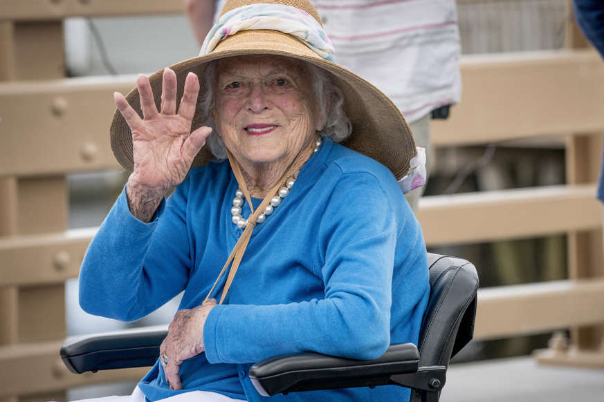 Former first lady Barbara Bush waves to the crowd as she arrives at the dedication of the Mathew J. Lanigan bridge on Friday, May 19, 2017.