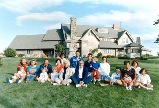 Slide 8 of 28: Portrait of the Bush family in front of their Kennebunkport, Maine August 24, 1986. BACK ROW: Margaret holding daughter Marshall, Marvin Bush, Bill LeBlond. FRONT ROW: Neil Bush holding son Pierce, Sharon, George W. Bush holding daughter Barbara, Laura Bush holding daughter Jenna, Barbara Bush, George Bush, Sam LeBlond, Doro Bush Lebond, George P.(jeb's son), Jeb Bush holding son Jebby, Columba Bush, and Noelle Bush.